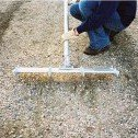 Use a modified bull float for grooving the concrete to provide nonslip footing for cattle and bison