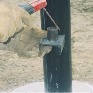 When building the channel iron hinge, cut a hole in the channel and weld the pipe sleeve to the bottom of the channel