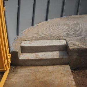 Steps on raised concrete platform