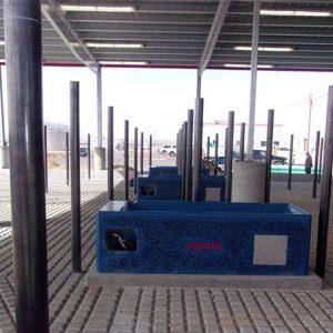 Water tank mounted on a concrete platform